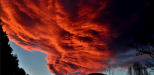 red clouds, low clouds, sunset poem
